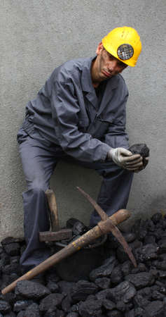 coal miner: Holding a stone coal miner with a pickaxe mining