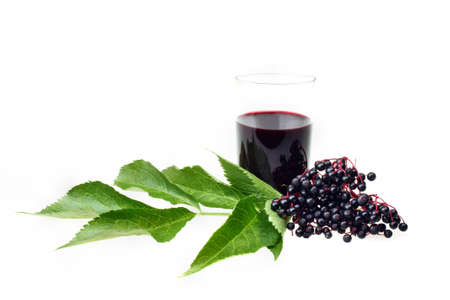 Elderberry wine and elderberries on white isolated background