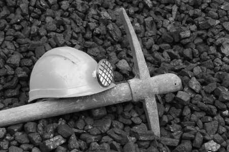death: Photo helmet and pick commemorating the death of miners, black and white photo