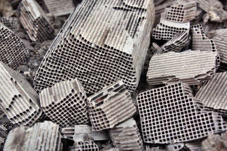 catalytic: Pices of broken catalytic converter. Pieces part of car catalytic converter having platinum, rhodium, palladium