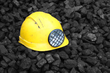 Helmet on top of the coal mining Stock Photo