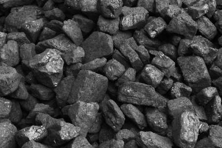tiled stove: Black coals from coal mine, stack of coal Stock Photo