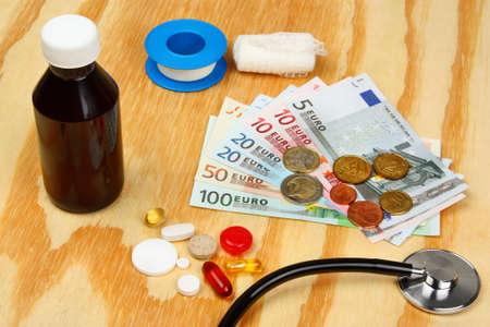 health care costs: Medical pills and stethoscope in euro money background as a symbol of health care costs