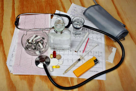amphetamine: Cigarettes in the ashtray, vodka, drugs on the table medical research