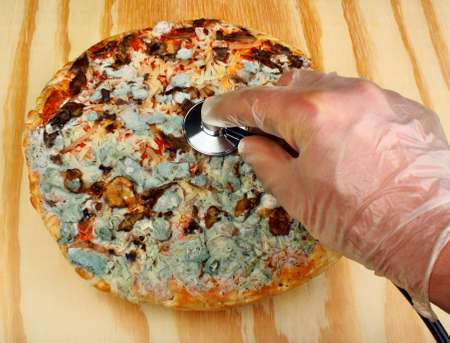 food inspection: Doctor medical examination old moldy pizza stethoscope