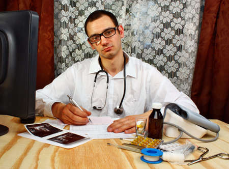 describes: The doctor describes the result of the medical examination in medical office