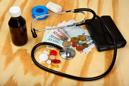health care costs: Medical pills,stethoscope in euro money background as a symbol of health care costs Stock Photo