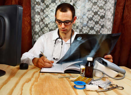 medicalcare: Medical doctor looking at x-ray picture of lungs in doctors office Stock Photo