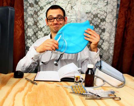 Doctor proctologist  holding an enema bag