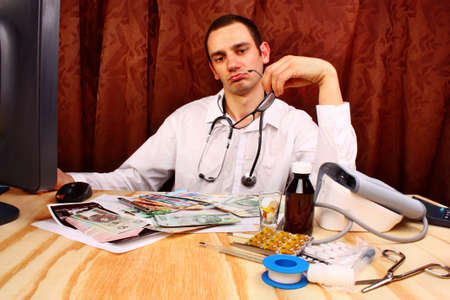 doctor money: Doctor have euro, polish money in doctors office Stock Photo