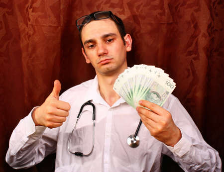 doctor money: Male medicine doctor in hold polish money and show OK or approval sign Stock Photo