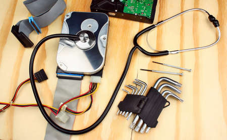 hard drive crash: Dead hard disk infected with computer virus and  stethoscope