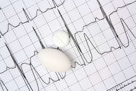 cardiological: Electrocardiogram ECG and white pills Stock Photo