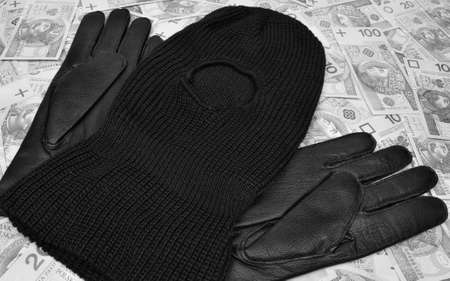 stickup: Things bandit criminal gun, balaclava, gloves, polish money  on the table Stock Photo