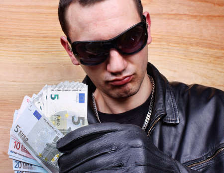 stolen: Chief boss mafia gangster thug with stolen money euro