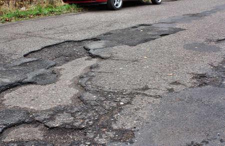 dangerous road: Car runs over holes and dangerous road