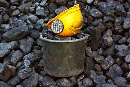 coal miner: Bucket of coal and helmet coal miner