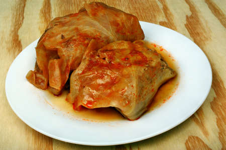 polish chicken: Stuffed cabbage rolls on the white plate and wooden table, Poland traditional food Stock Photo