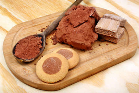 decaf: Fresh cocoa powder and cakes, on a wooden table Stock Photo