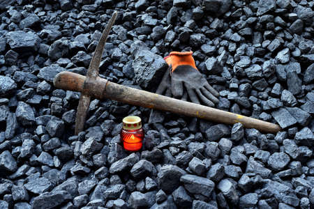 Vigil light, candle with the minerals (gloves, pickaxe) after the fatal accident in the mine