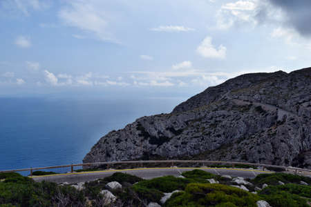 Amazing landscape when driving on an open coastal road winding through to lighthouse Cap Formentor, Mallorca, Spain