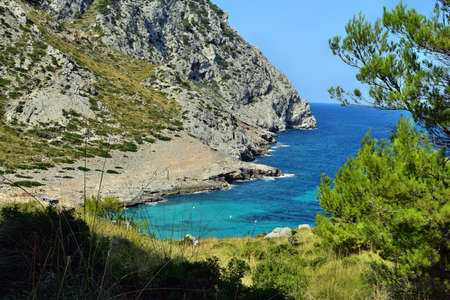 Beautiful sea bay with turquoise water, beach and mountains, Cala Figuera on Cap Formentor, Mallorca, Spain
