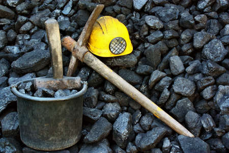 Mining tools on a background of coal