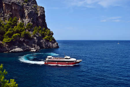 Sa Calobra, Mallorca, Spain - August 30, 2018: Sea bay with turquoise water, beach and mountains