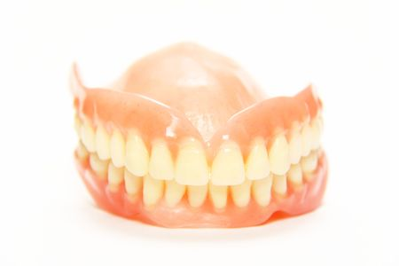 The total denture upper and lower on a white background photo