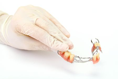 fix jaw: Dentures on a hand