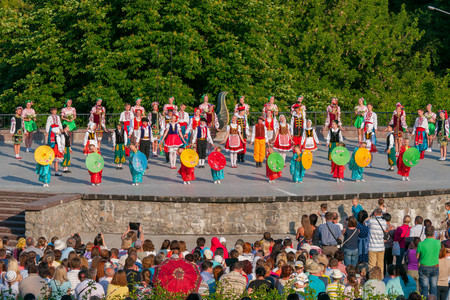 KIEV, UKRAINE - July 22 , 2016: Ukraina School of Dance Ensemble girls and boys dressed in traditional red Ukrainian embroidered costume clothes dancing