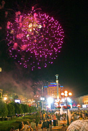 bright pink lights of beautiful fireworks in the citys night sky on Independence Square. Kiev. Ukraine