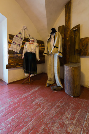 Museum exhibition of old Ukrainian men's and women's clothes Stock Photo