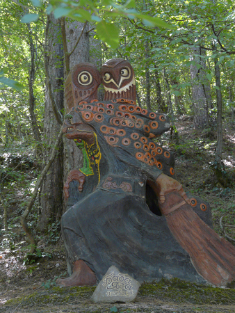Terrific wooden statue of the Baba Yaga in the park. A place to visit tourists