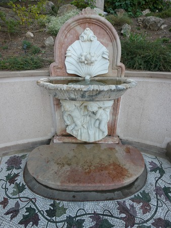 fountain in the form of two angels holding a conch with pearls