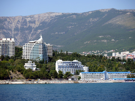Luxury hotels with their own beaches near the sea on the background of high green mountains