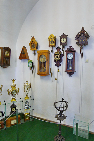 A lot of different and ancient wall clock with cuckoo, very beautiful thing for a vintage interior