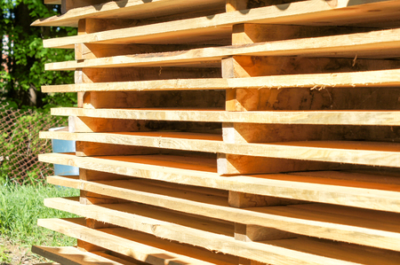 Wooden pallets stacked in the open air. For your design