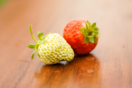 White and red strawberries lie in the sun. Delicious and sweet dessert berry. Vitamins .For your design Stockfoto
