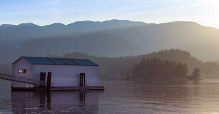 Boathouse on an inlet near Deep Cove at sunrise. Stock Photo