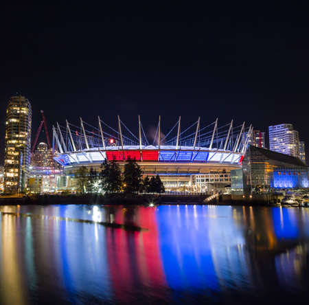 VANCOUVER, BC, CANADA - NOV 16,2015: BC Place, in False Creek, displaying the French tricolore as a show of support in the week following the attacks in Paris. Editorial
