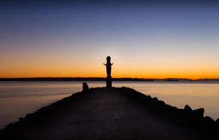 Totem pole at Ambleside Park, West Vancouver, just after sunset. Stock Photo