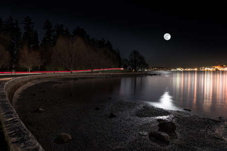 Moon rising over the city viewed from Vancouvers Stanley Park.
