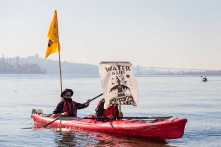 NORTH VANCOUVER, BC, CANADA - OCT 28, 2017: Kayakers participating in a protest of the Kinder Morgan Pipeline on Burnaby Mountain.