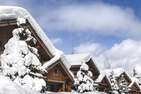 Snow covered rooftops of mountain cabins in Whistler. Stock Photo