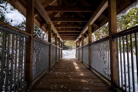 Covered wooden bridge at Brandywine Falls Provincial Park. Stock Photo