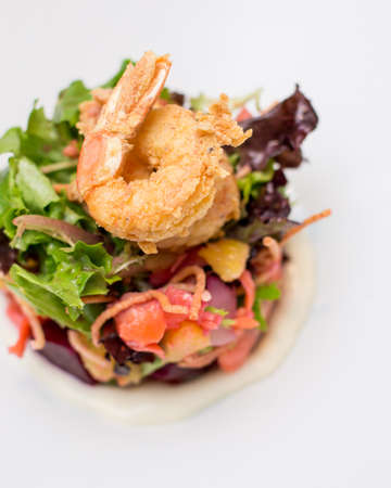 A prawn salad with beets on a white plate. Stockfoto