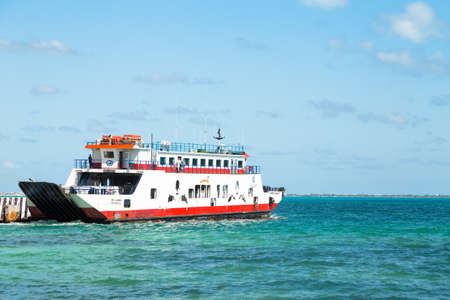 CANCUN, QR, MEXICO - FEB 11, 2018: Cancun to Isla Mujeres passenger ferry leaving Cancun on a sunny day.