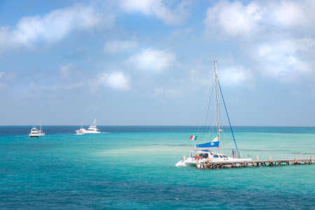 A catamaran and other boat near the shore on Isla Mujeres, Mexico