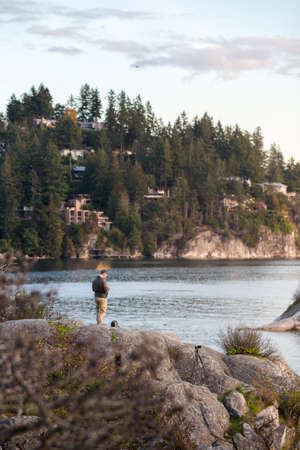 A man flies his drone over the ocean at Whytecliff Park., West Vancouver. Imagens